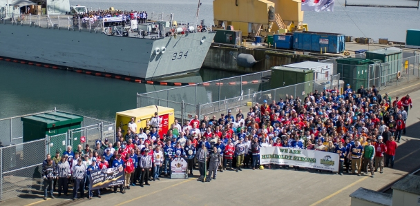 Fleet Maintenance Facility (FMF) Cape Breton and HMCS REGINA wear jerseys to work in support of the bus accident with the Humboldt Broncos Junior Hockey Team at FMF Cape Breton D-250 HMC Dockyard, CFB Esquimalt on 12 April 2018. Photo: Leading Seaman Valerie LeClair, MARPAC Imaging Services ©2018 DND-MDN CANADA